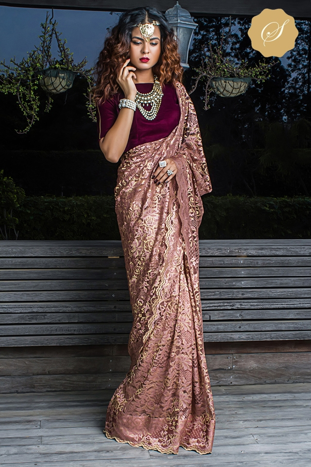 Pic 4- This lace saree will give you the royal look this wedding season. The velvet blouse along with the saree only adds on to the look, adding on to the class in your look
